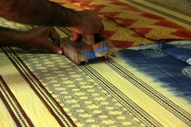 One of the most eye-catching craft to be practiced by the local communities in the arid deserts of Kutch in Gujarat and Sindh in Pakistan, Ajrakh is a double-sided block printed textile, which is still prepared in the traditional way.